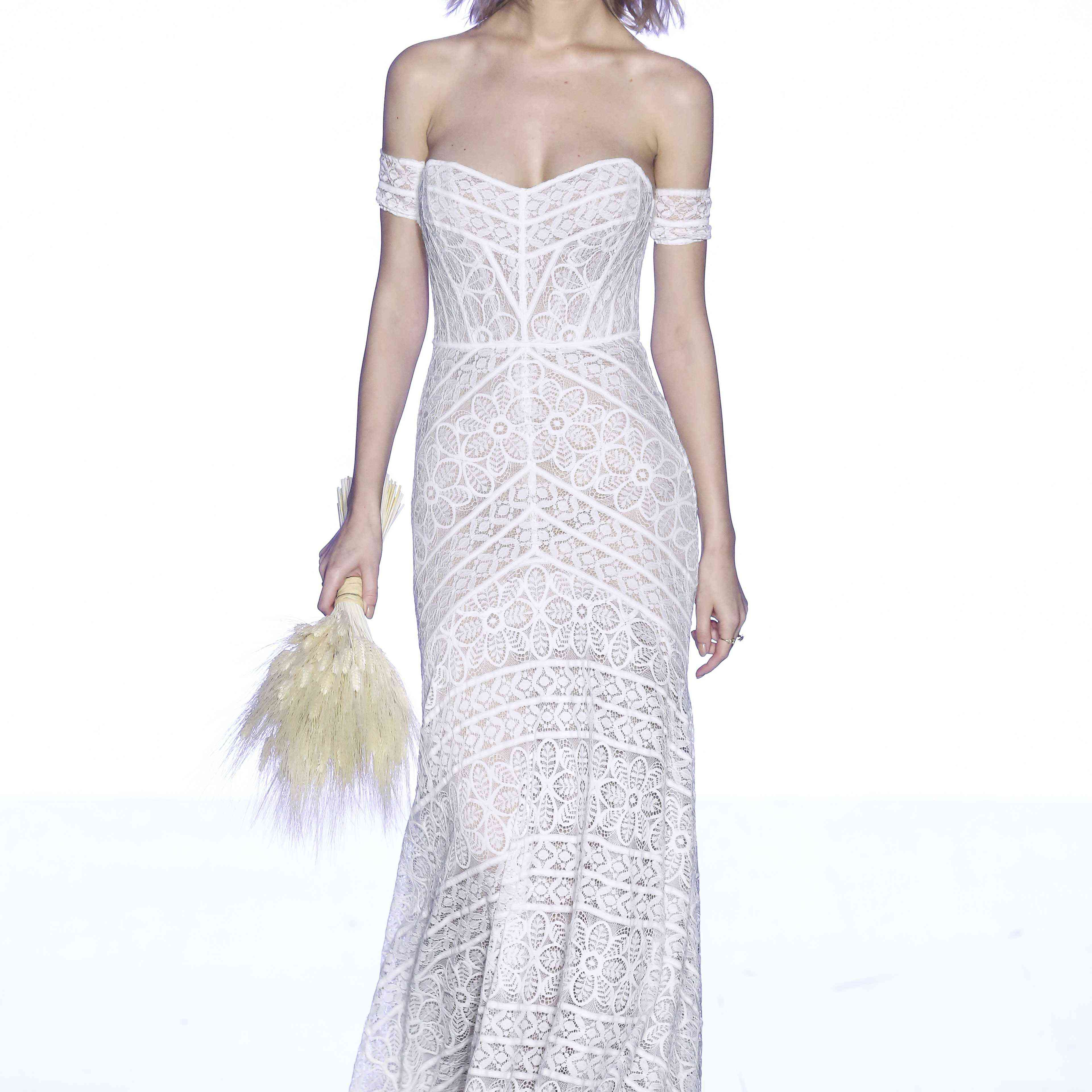 Model in strapless lace gown with off-shoulder band sleeves