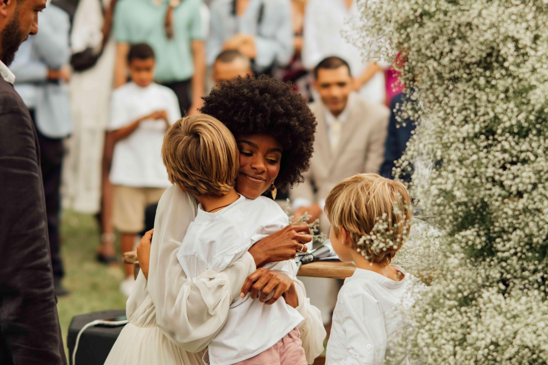 bride hugging ring bearers