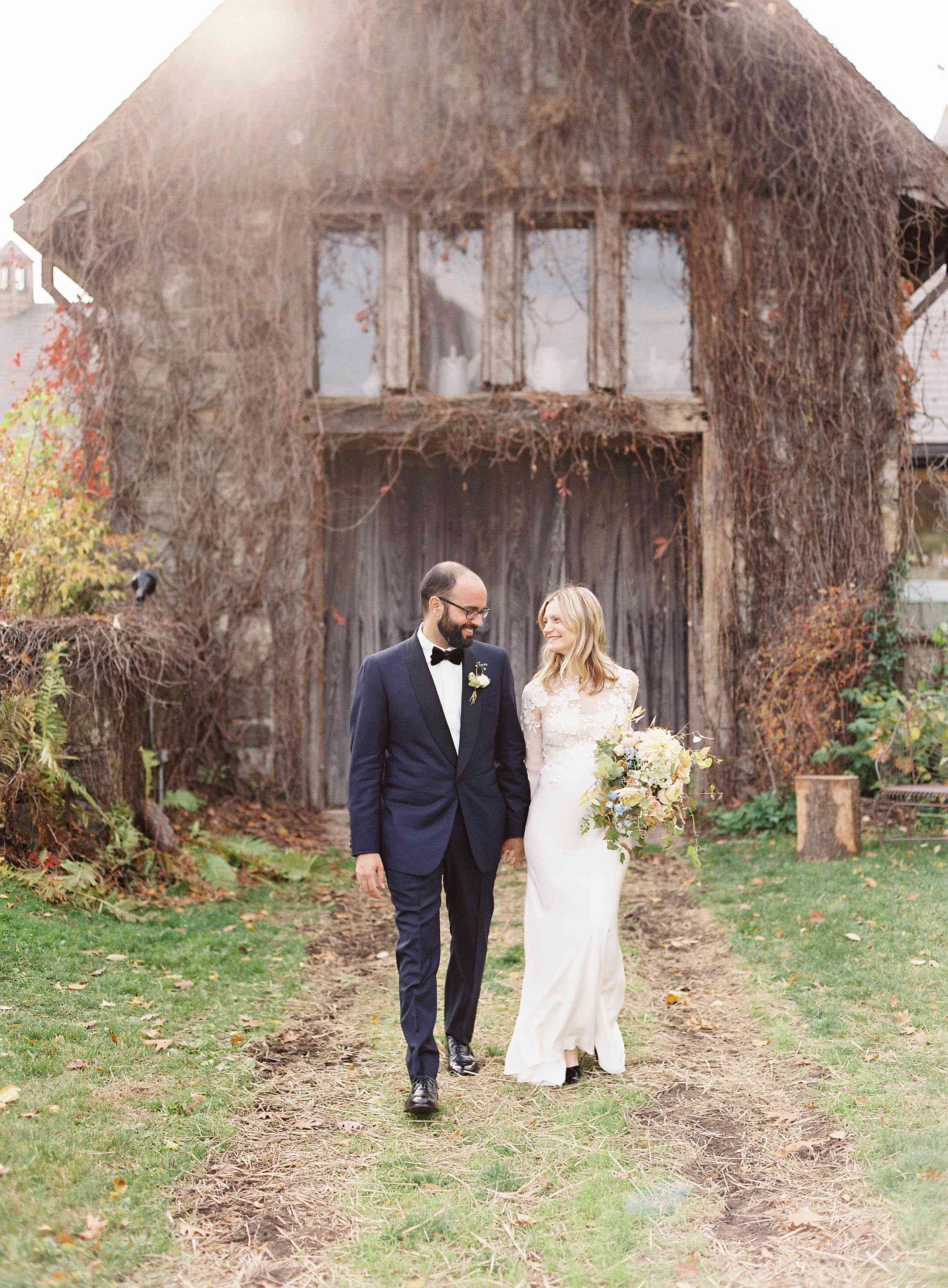 <p>Bride and groom outside barn</p>