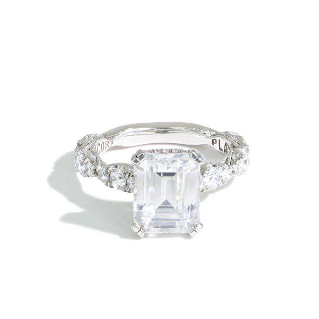 hidden halo emerald cut engagement ring