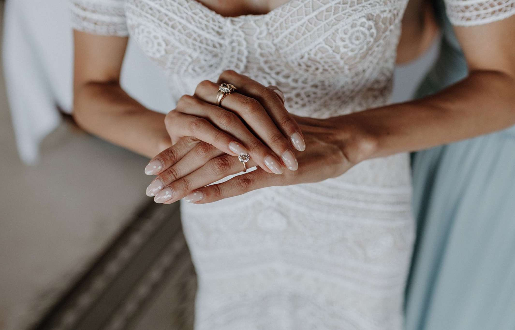 Bride with a neutral manicure with white polka dots