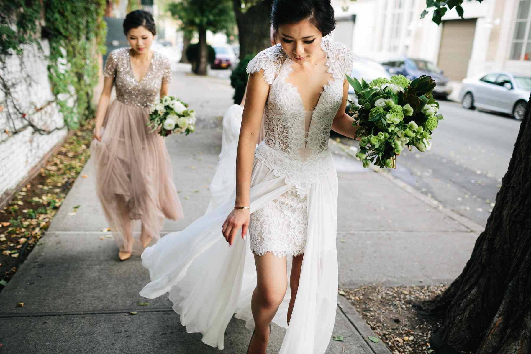 Bride walking with bridesmaid