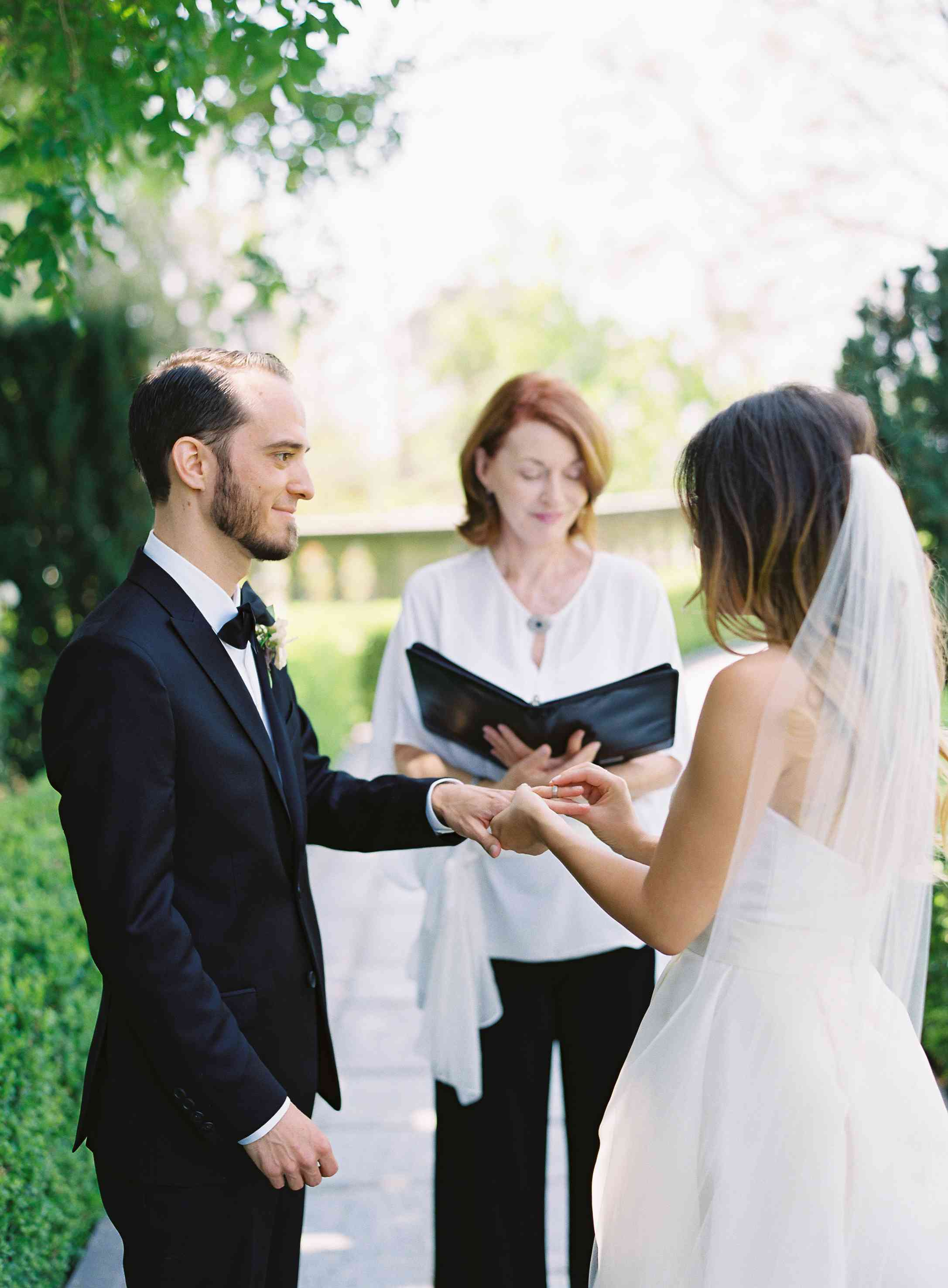 The couple exchanges vows at Greystone Mansion