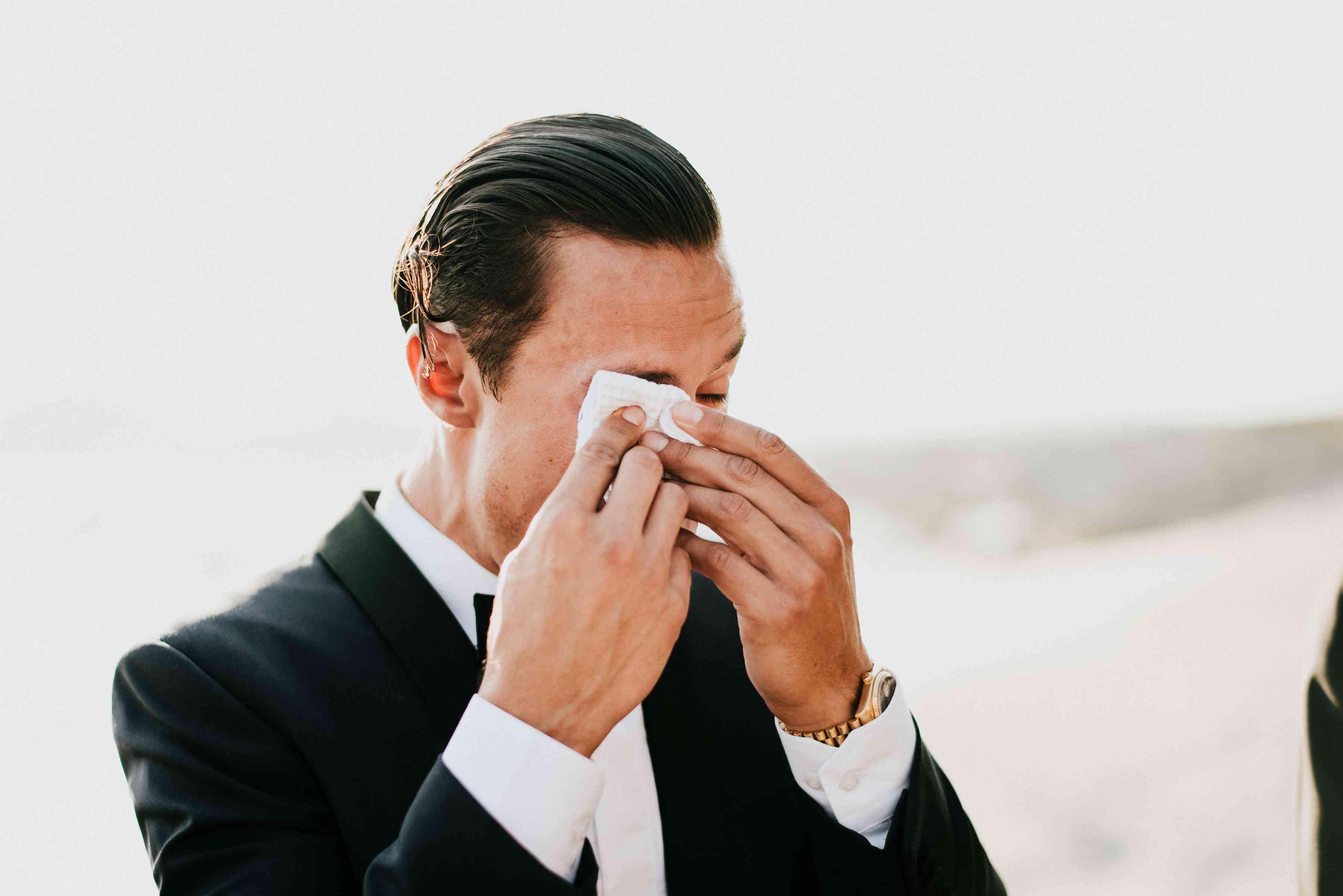 Groom crying at altar
