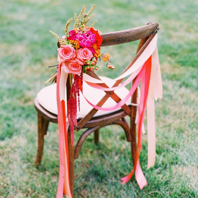 Wooden chair with pink ribbons