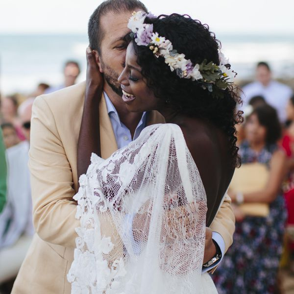 bride and groom kissing on the cheek