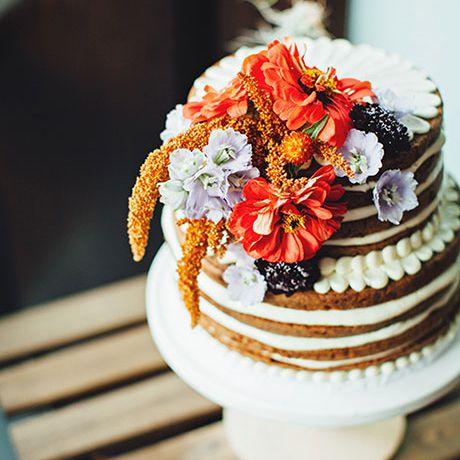 Two-tiered naked carrot cake with fall florals