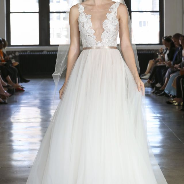 Model in white ball gown wedding dress with floral illusion bodice