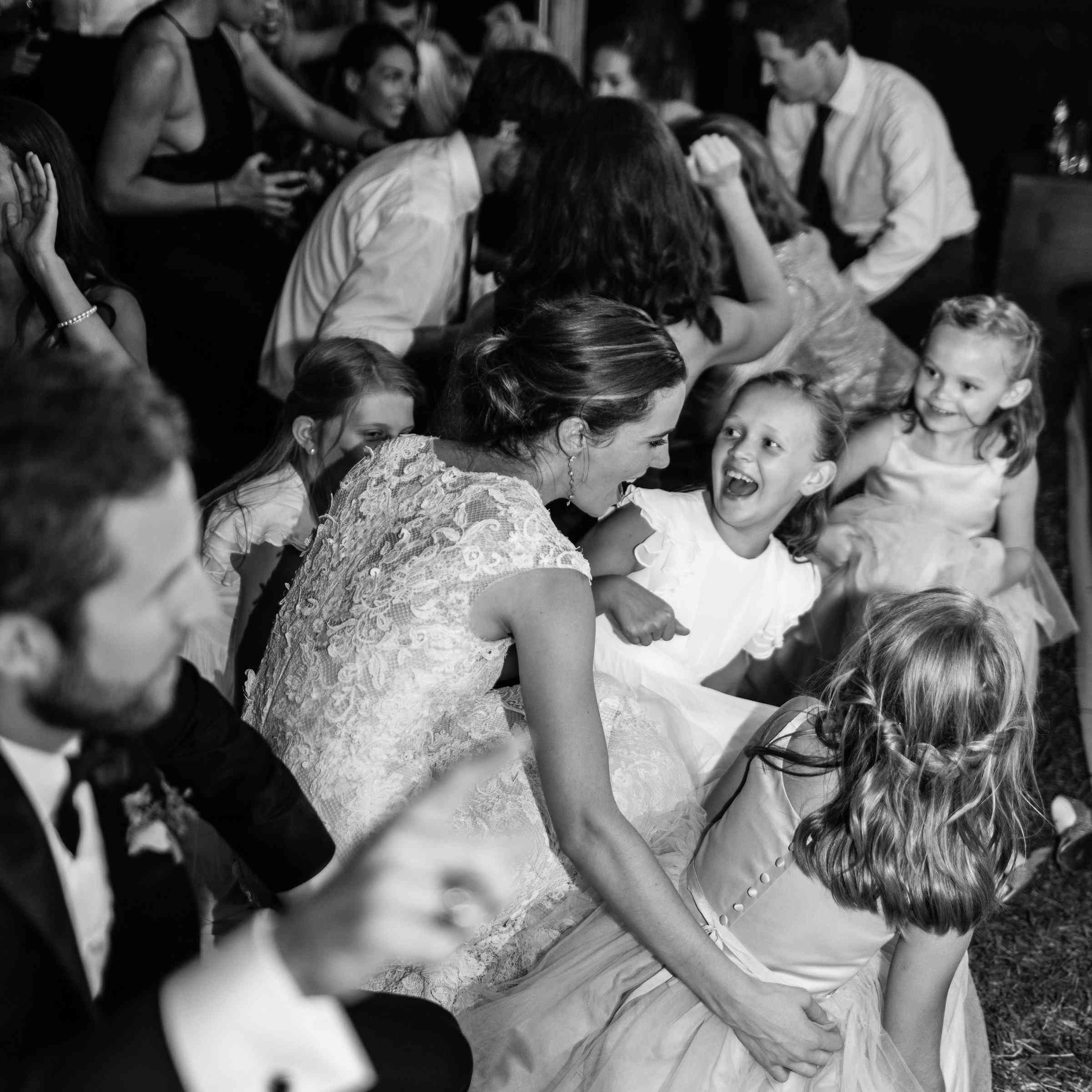 <p>Bride dancing with flower girls</p><br><br>
