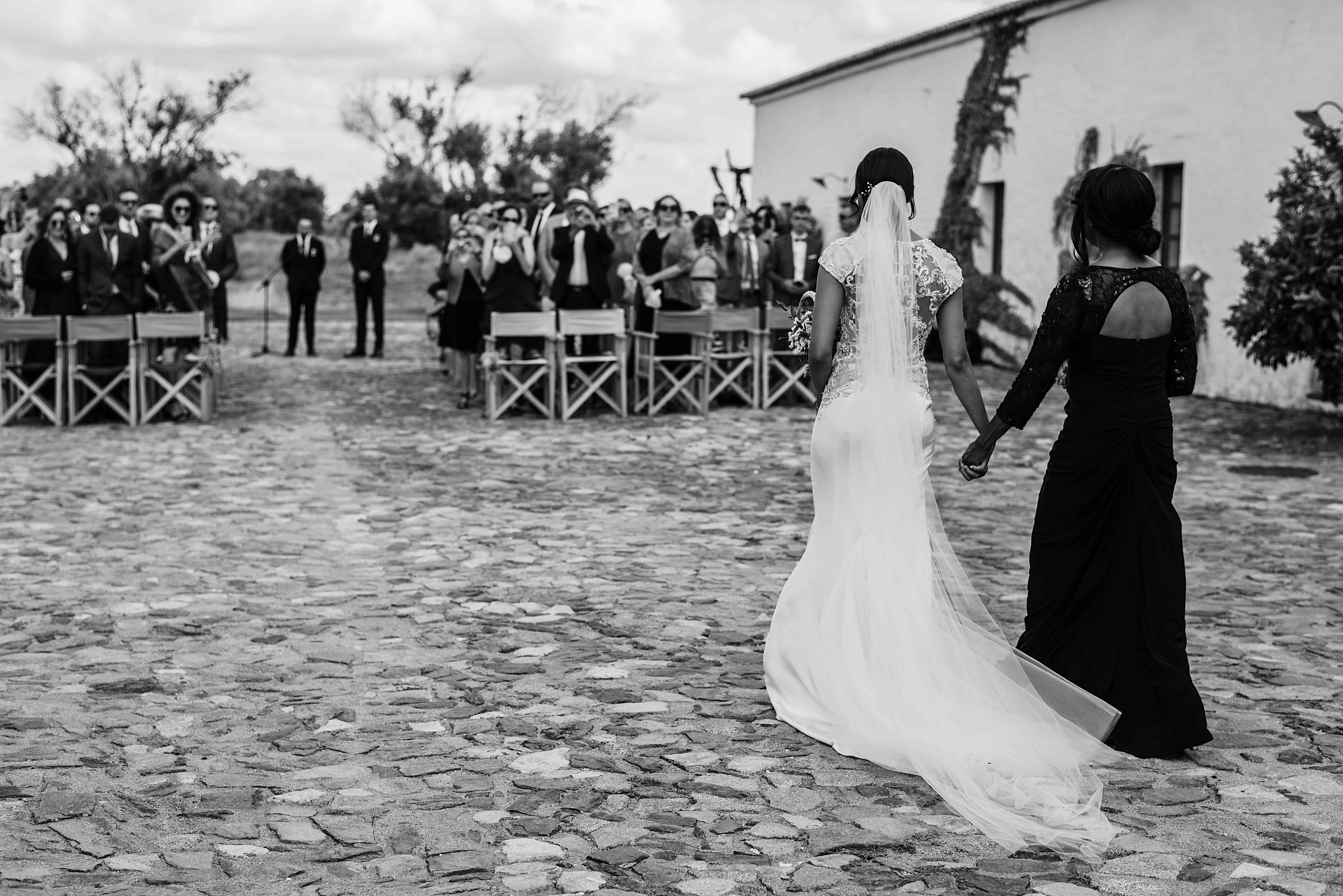 Bride and mother entering cermeony