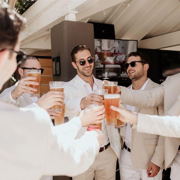 groomsmen holding beers