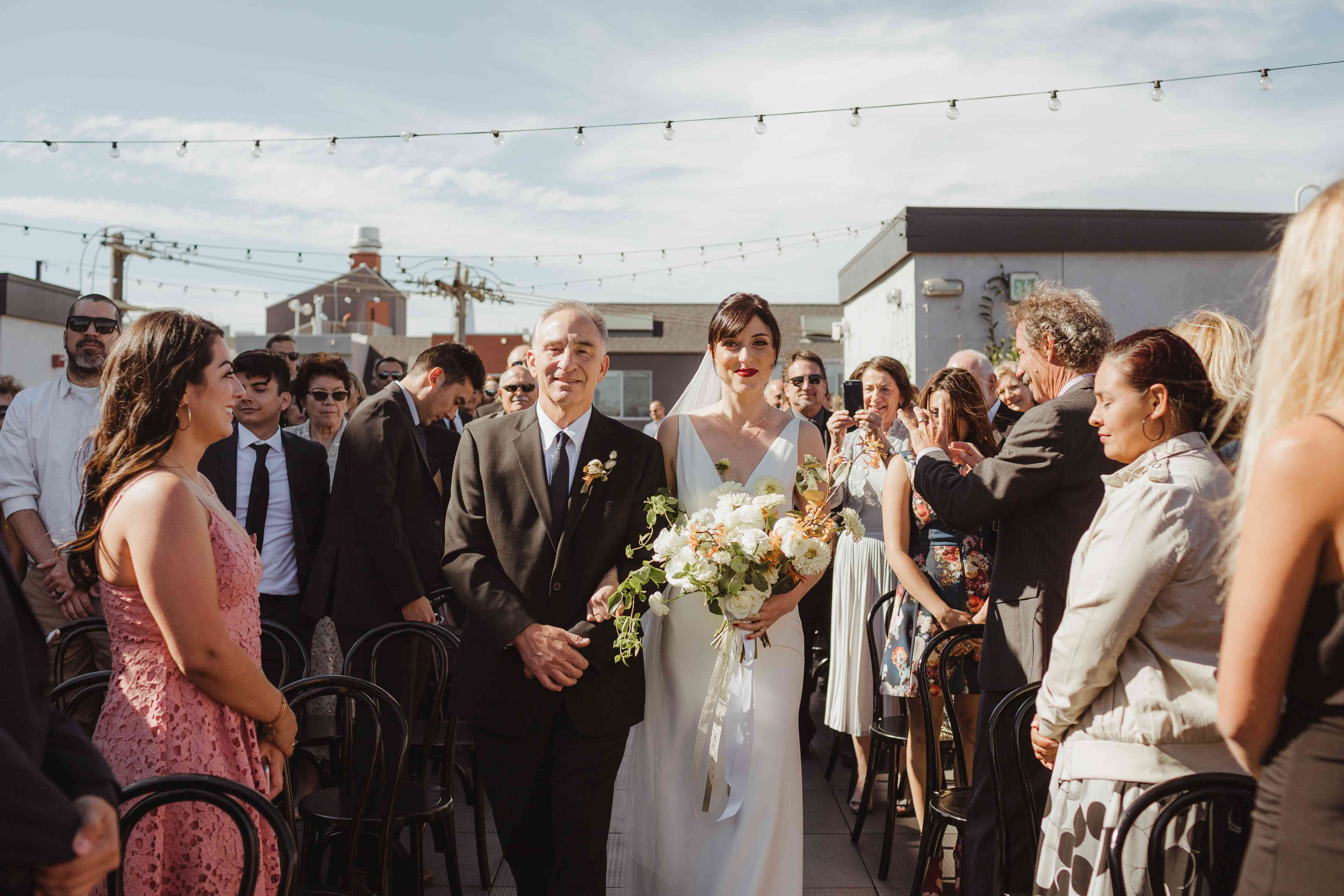 <p>father of the bride walking down the aisle</p><br><br>