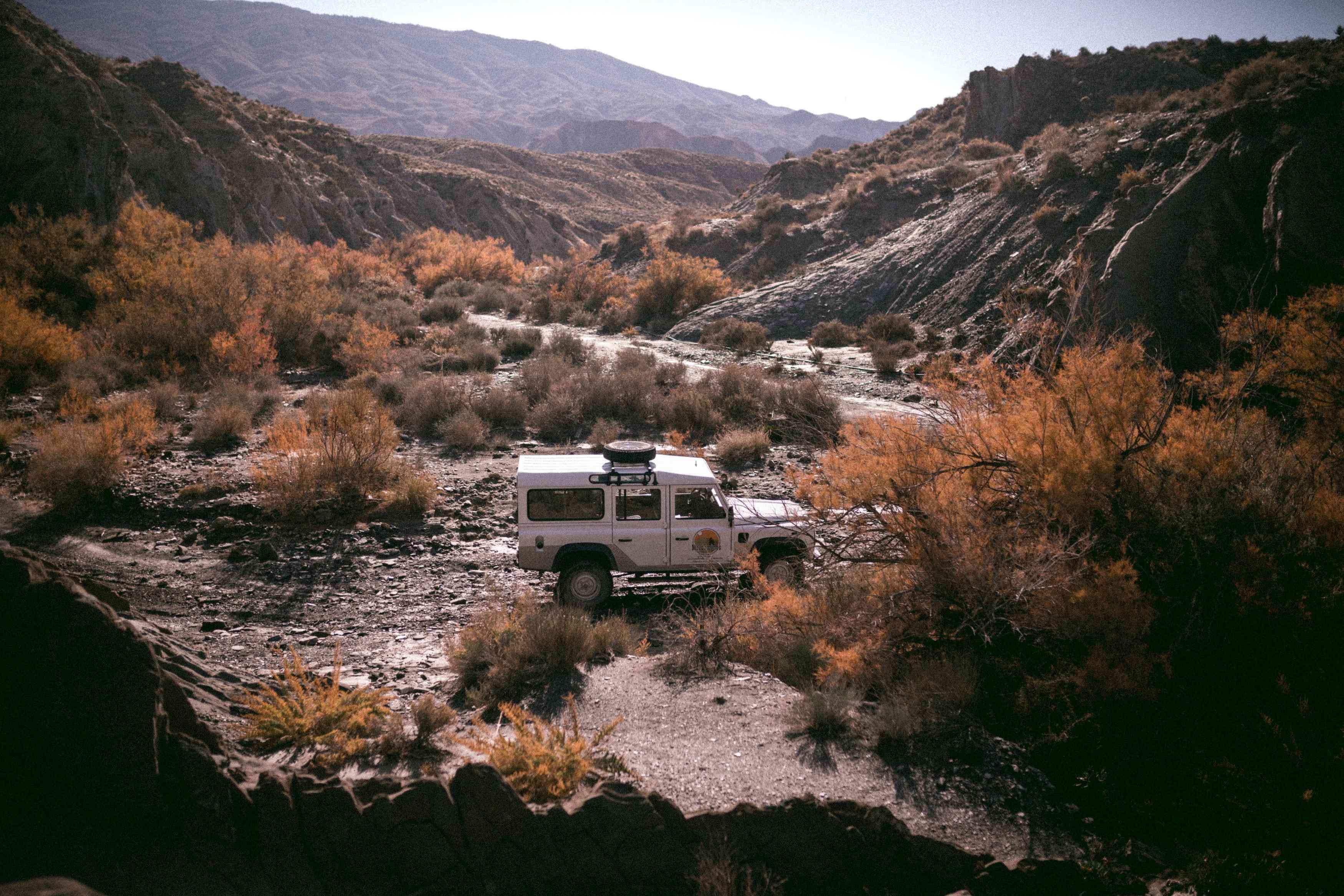 A truck driving through the Tabernas Desert in Spain