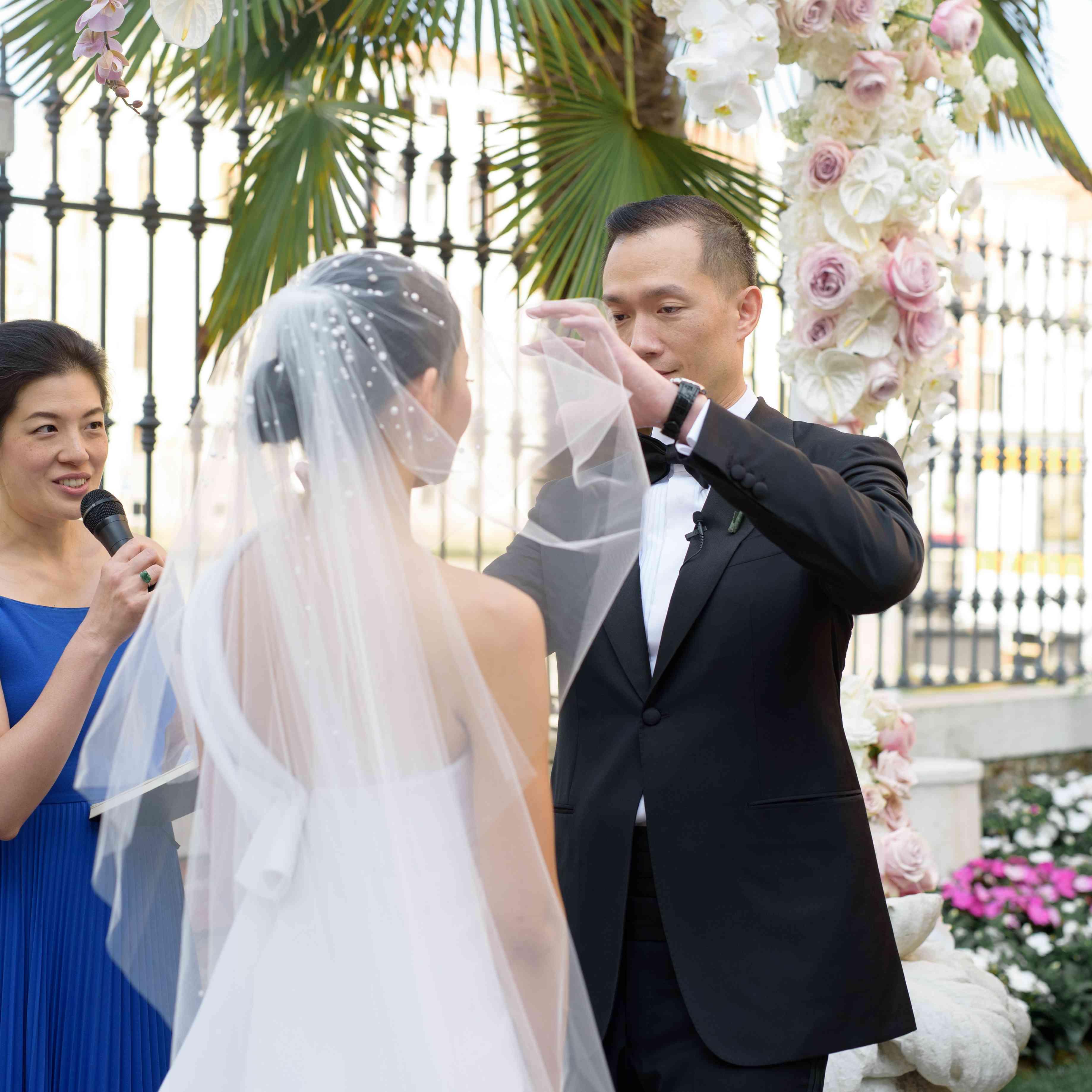 modern venice wedding, groom lifting brides veil