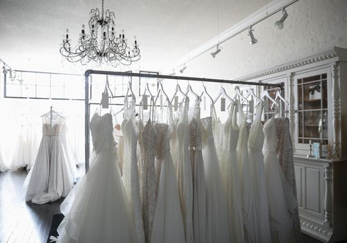 Wedding dresses on rack in bridal boutique