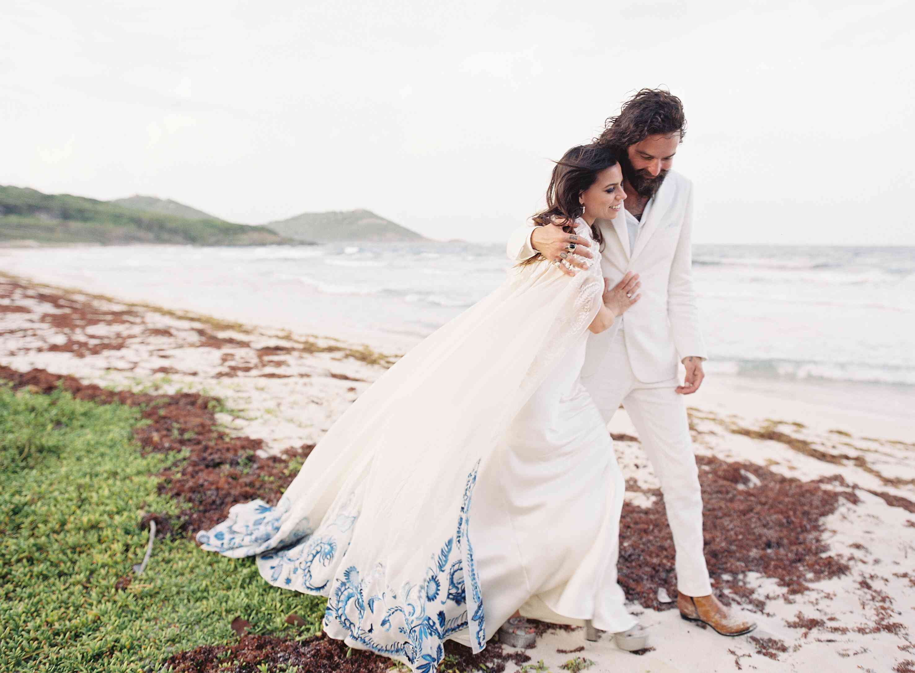 bride and groom by the ocean