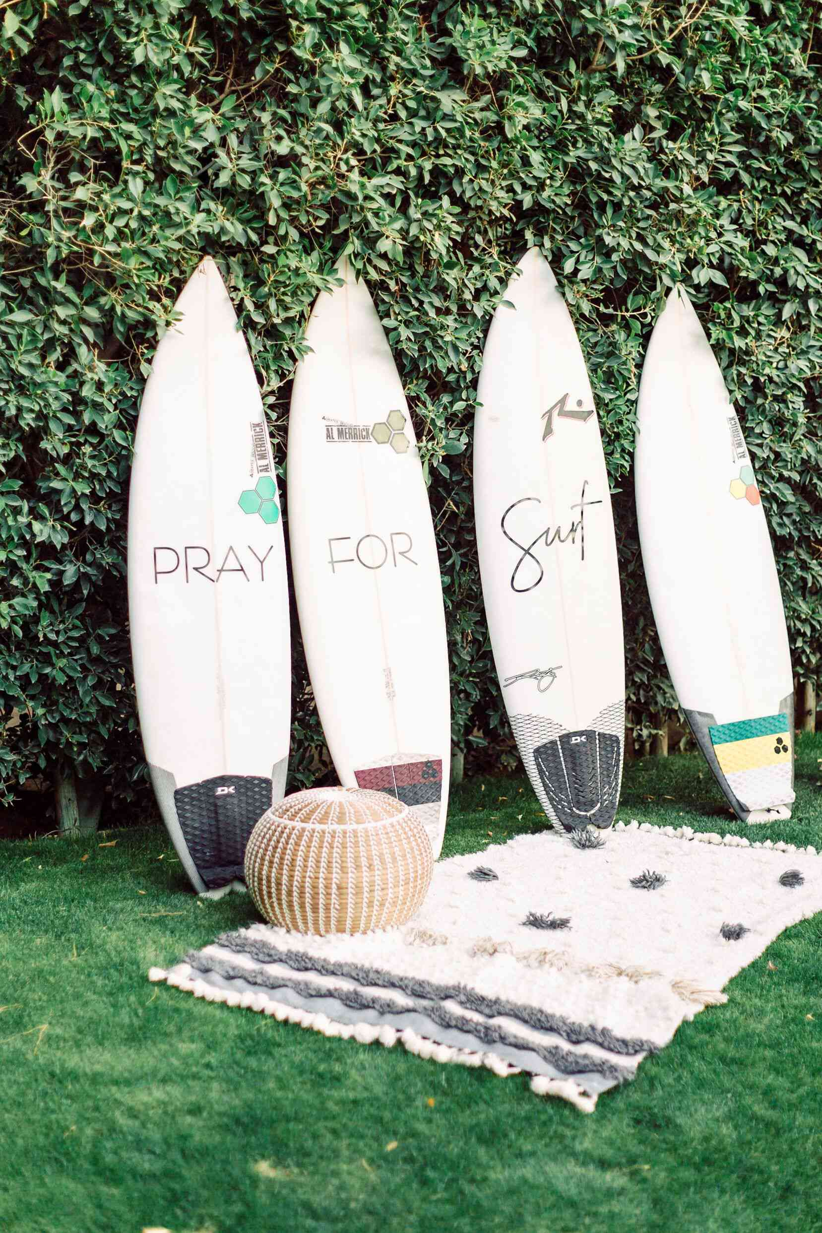 Surfboards at wedding reception as guest book