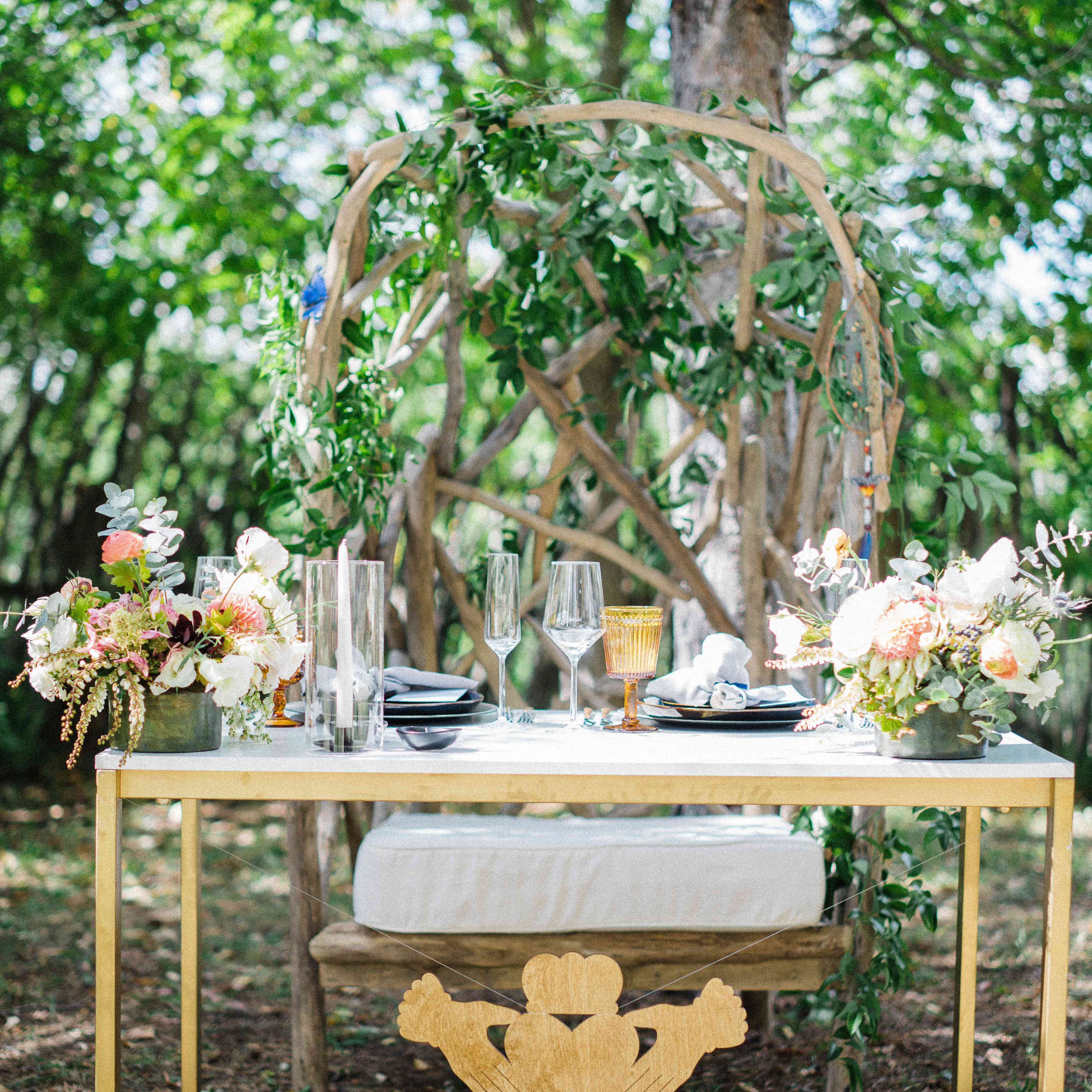 Sweetheart table with loveseat of woven branches