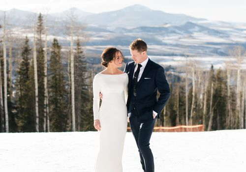 bride and groom snow