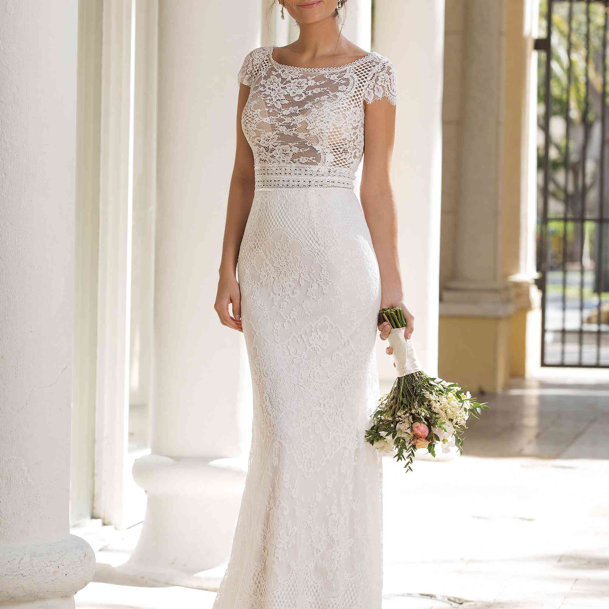 Model in illusion bodice gown with allover lace