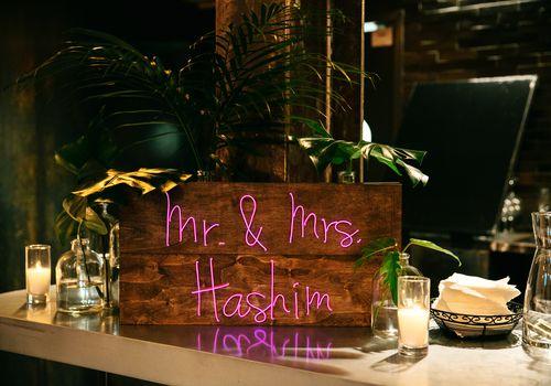 <p>Wooden neon wedding sign</p>