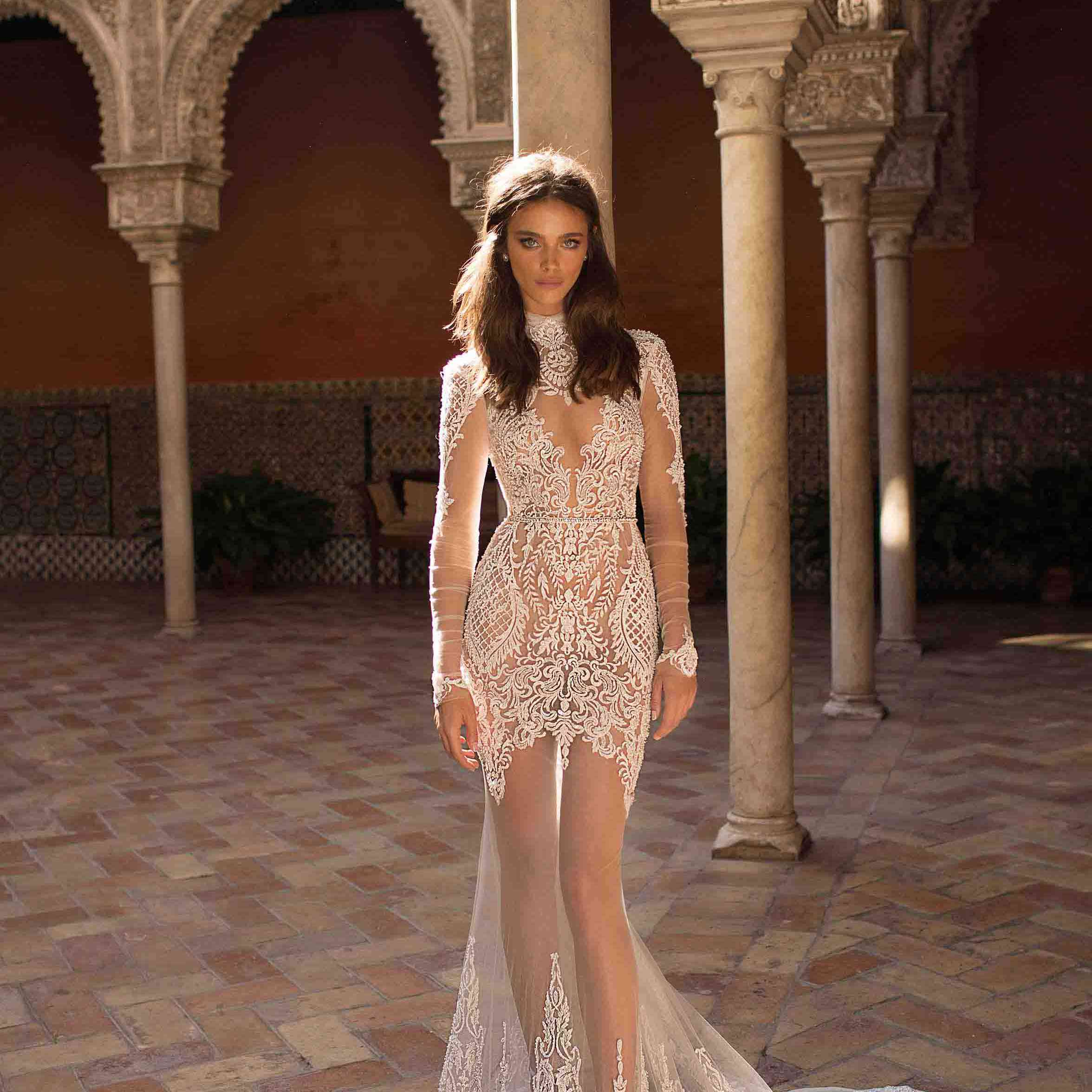 Model in sheer wedding gown with lace detailing