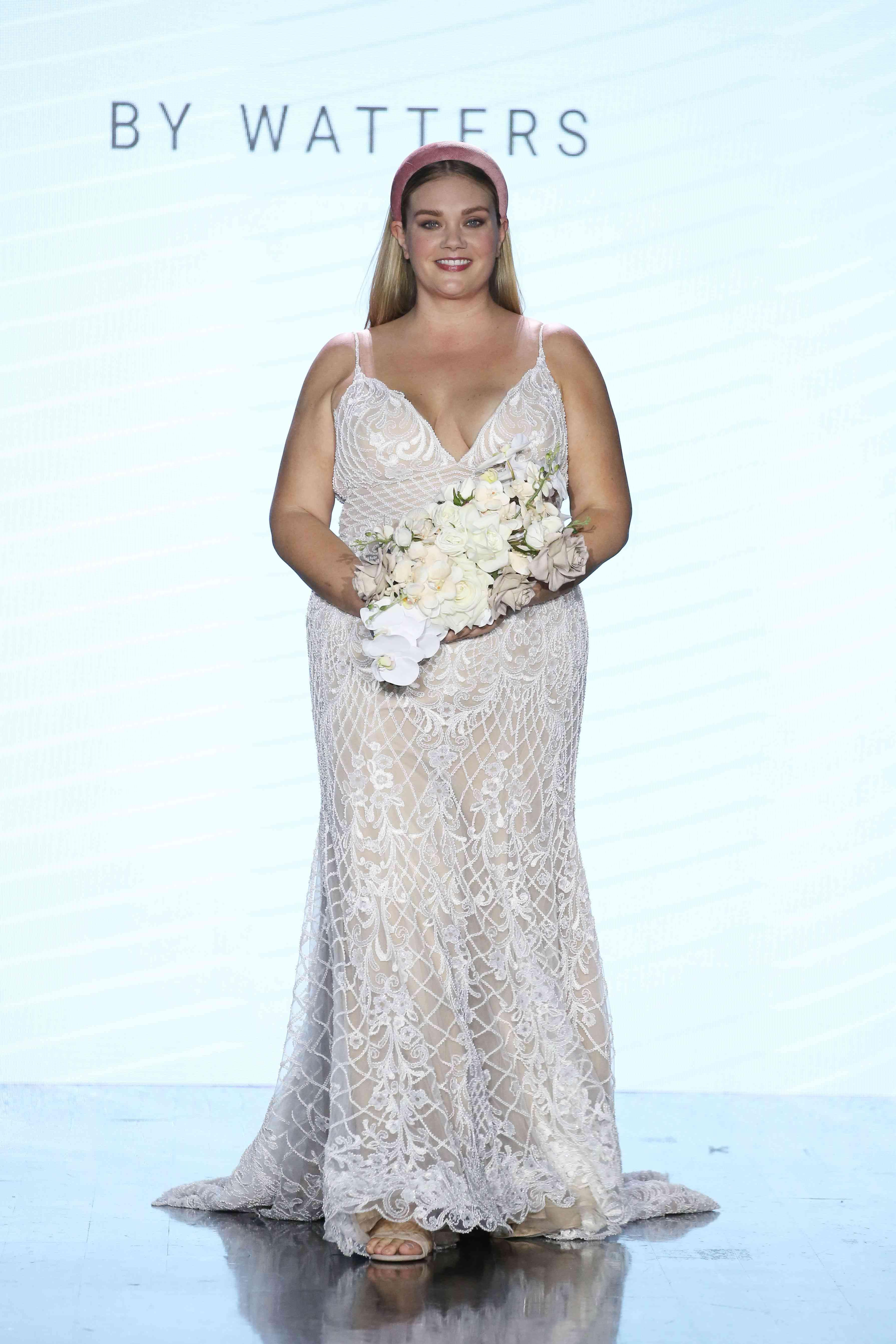 Model in V-neck wedding dress with allover floral beading