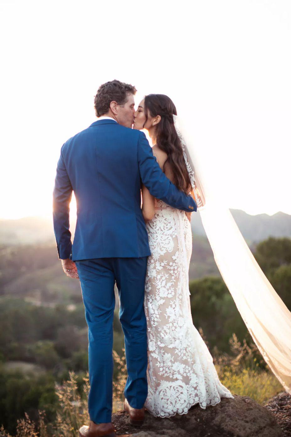 Back shot of newlyweds kissing