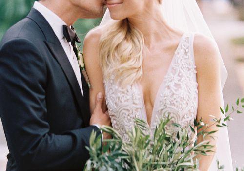 <p>Groom Kissing bride</p>