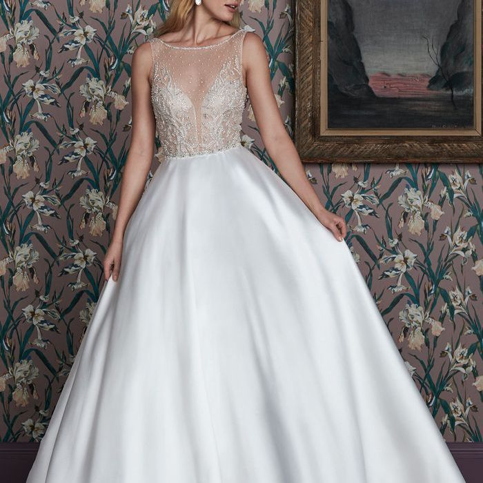 Model in illusion bodice ball gown wedding dress