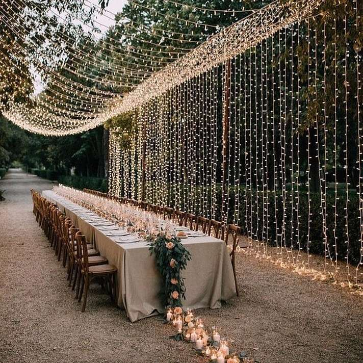 String lights over wedding reception table