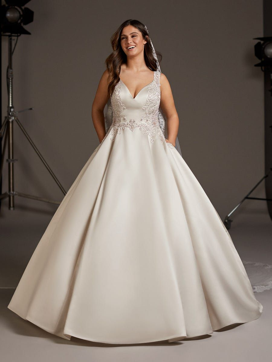 Plus size model in beaded ball gown with pockets