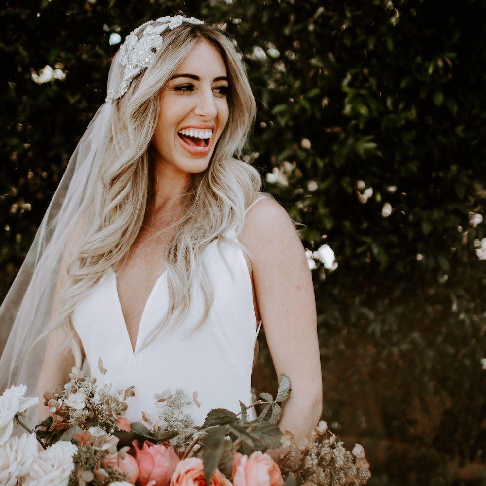 Bride smiling holding bouquet