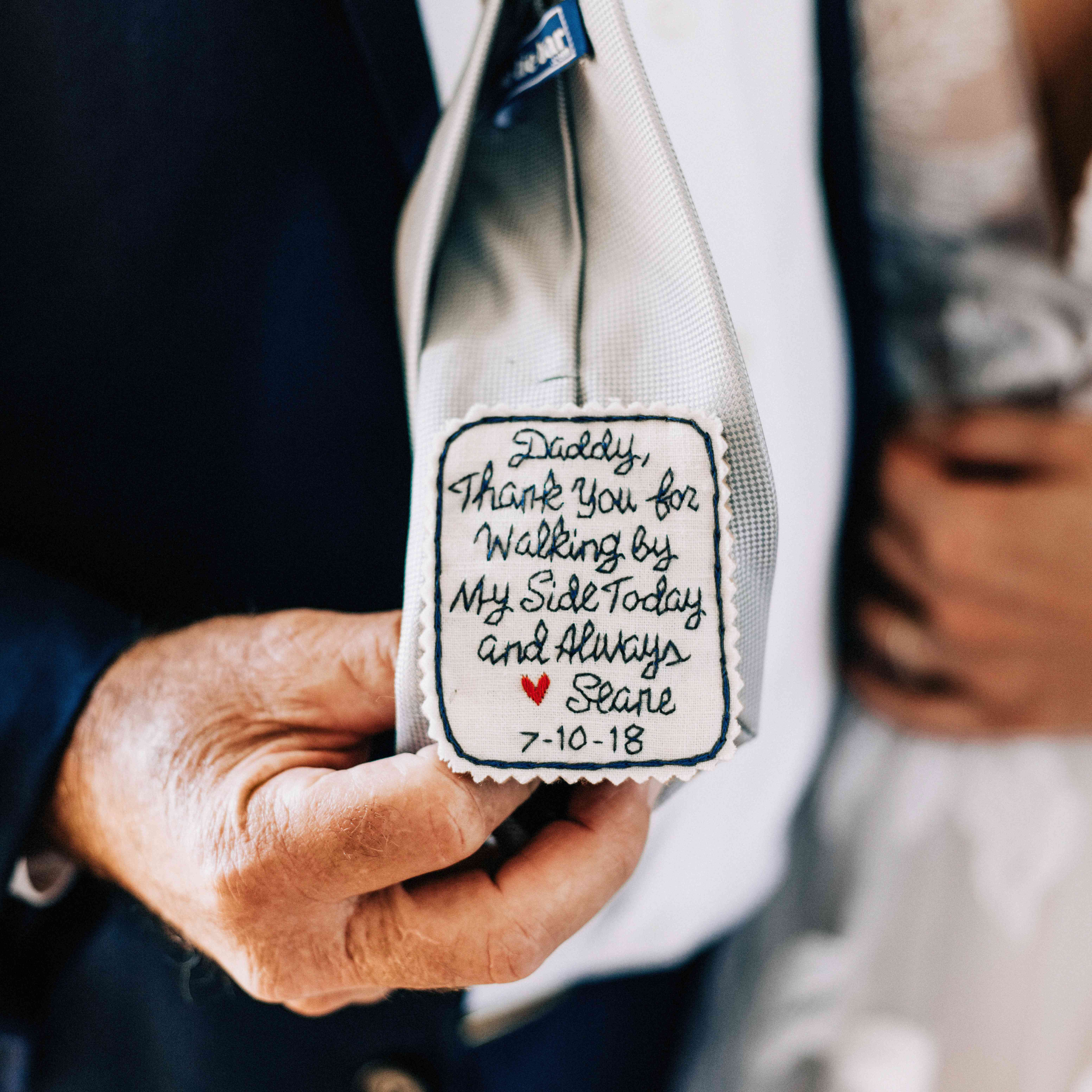 Love note from son stitched into the inside of the groom's tie