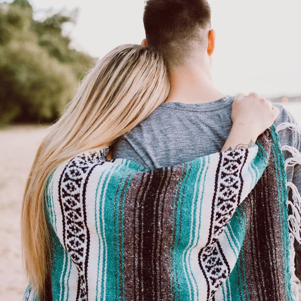 couple leaning on shoulders