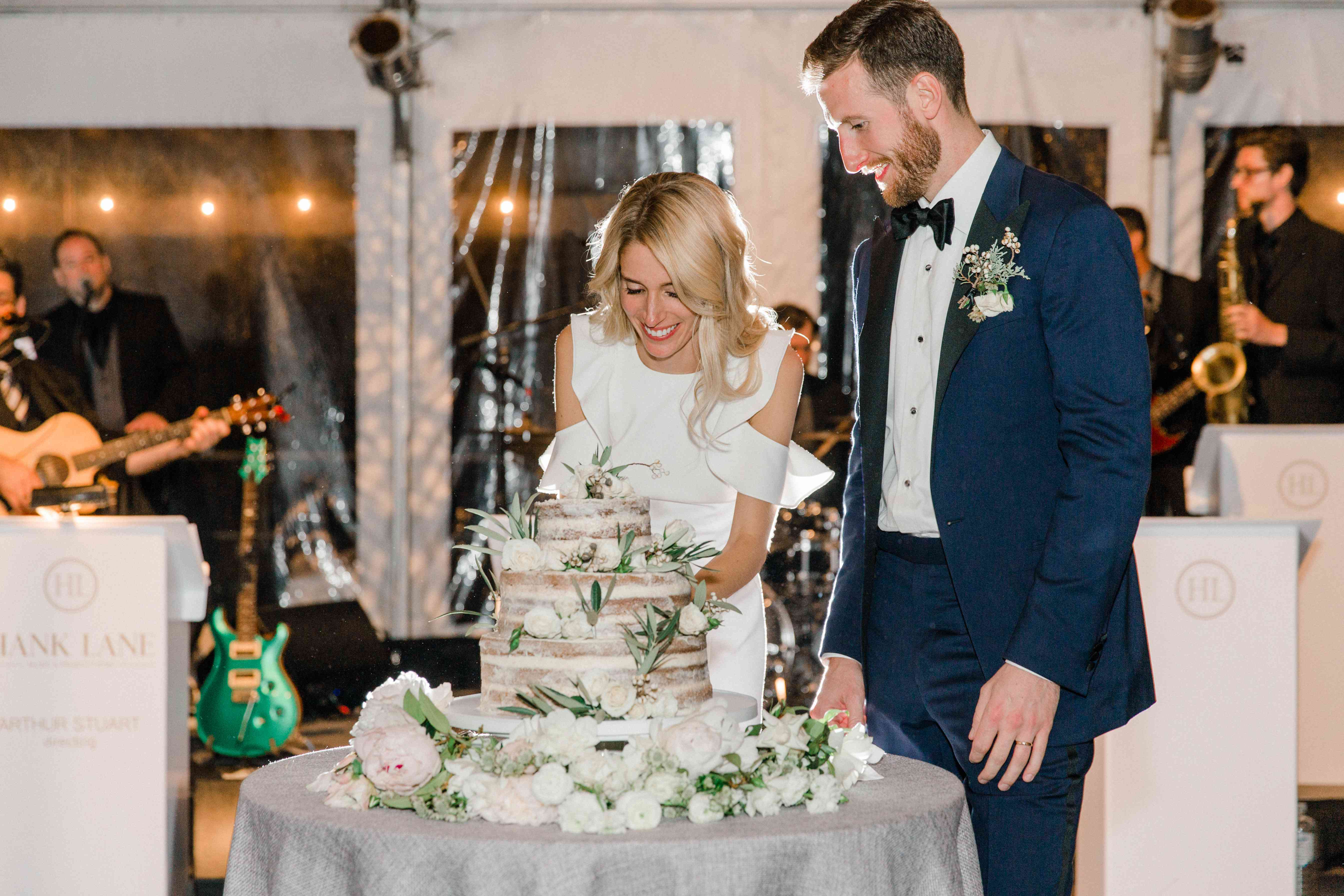 <p>cutting wedding cake</p><br><br>