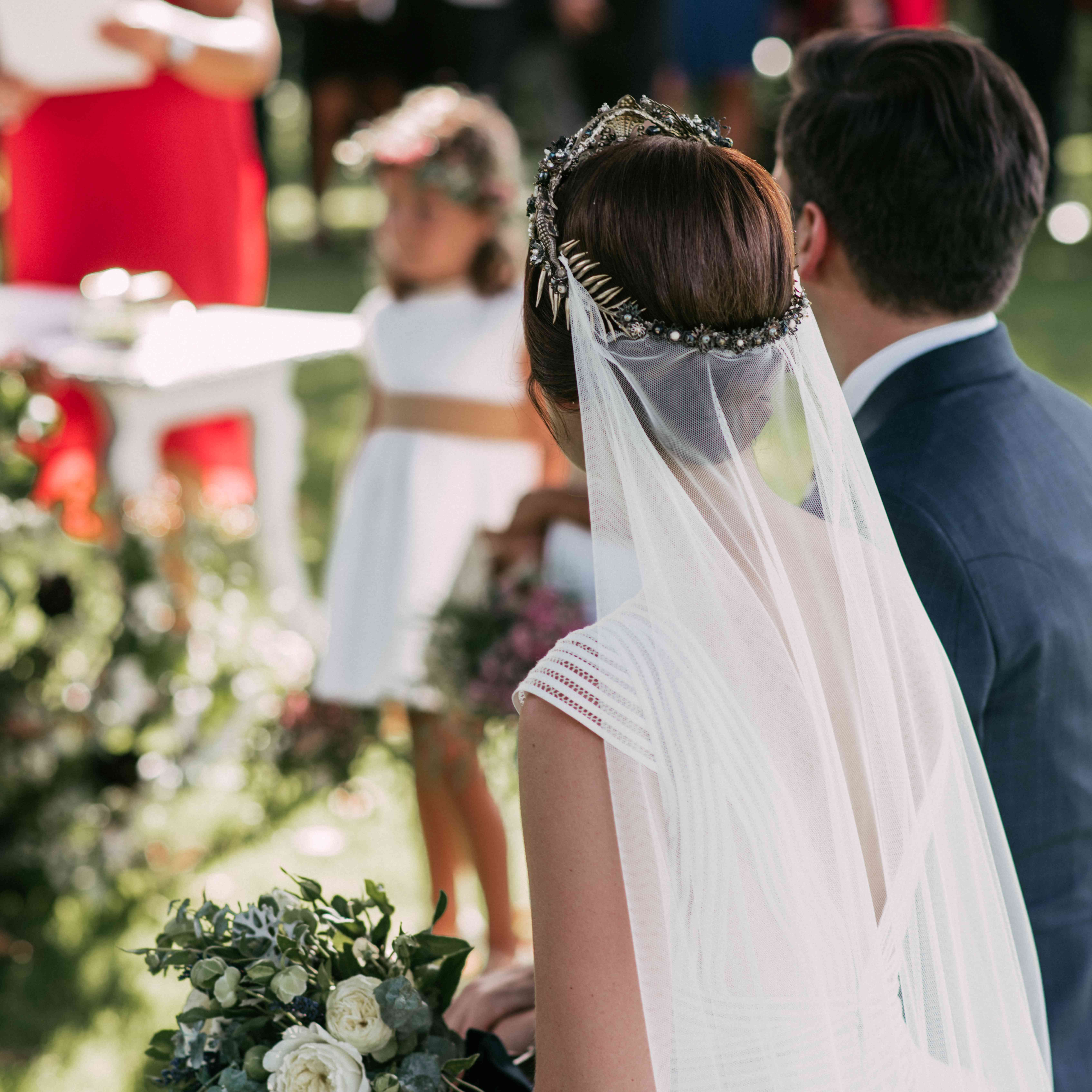 Bride and groom from behind at ceremony