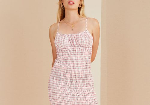 Woman in pink-and-white gingham dress.