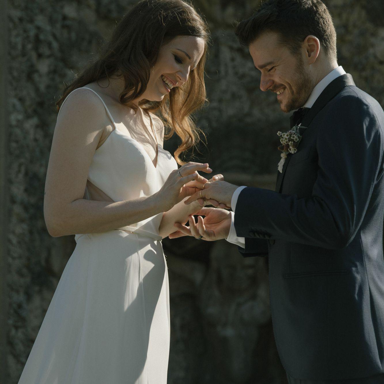 exchanging rings putting on wedding bands