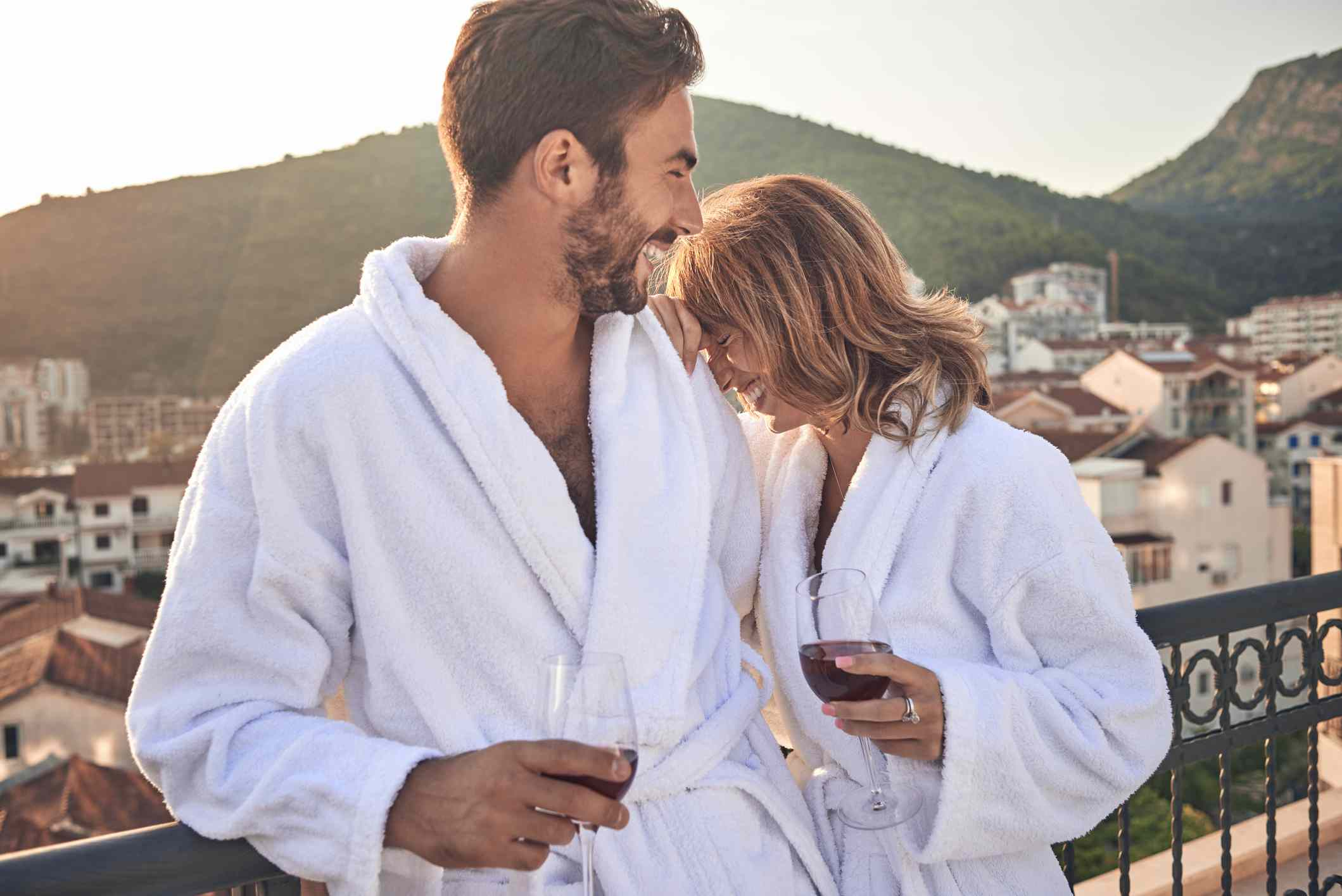 Couple laughing in robes