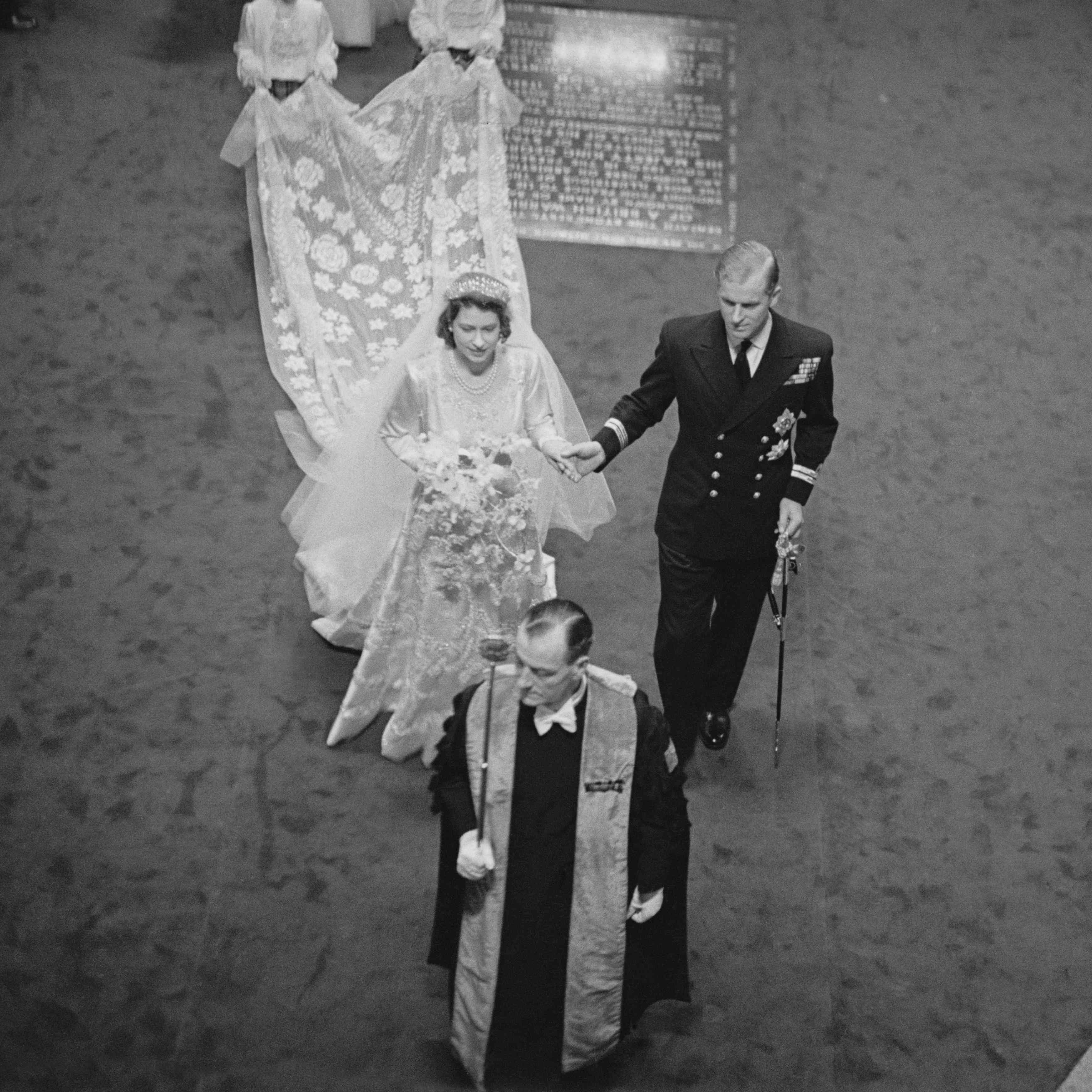Princess Elizabeth and Prince Philip walk down the aisle of Westminster Abbey on their wedding day