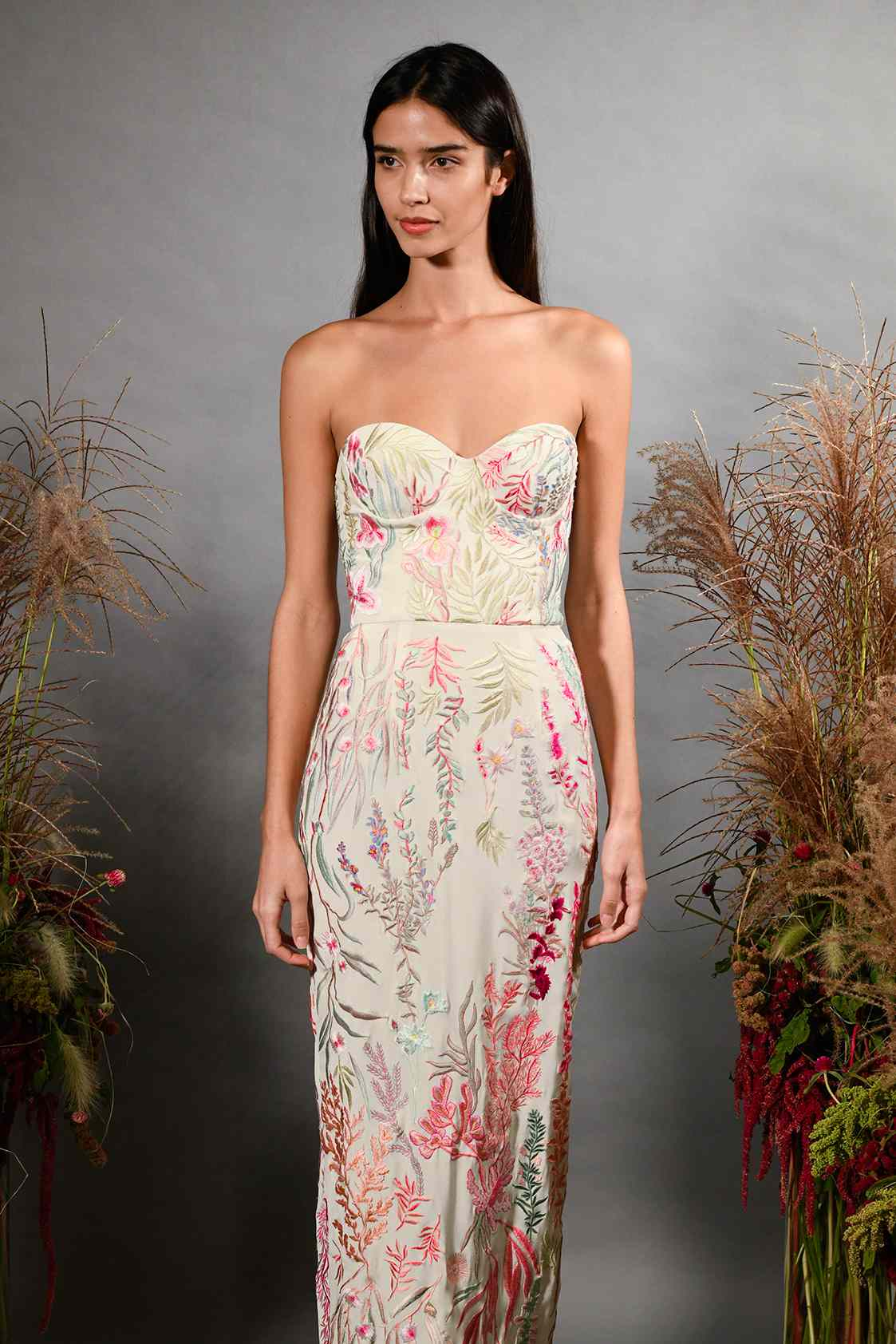 Model in strapless embroidered wedding dress