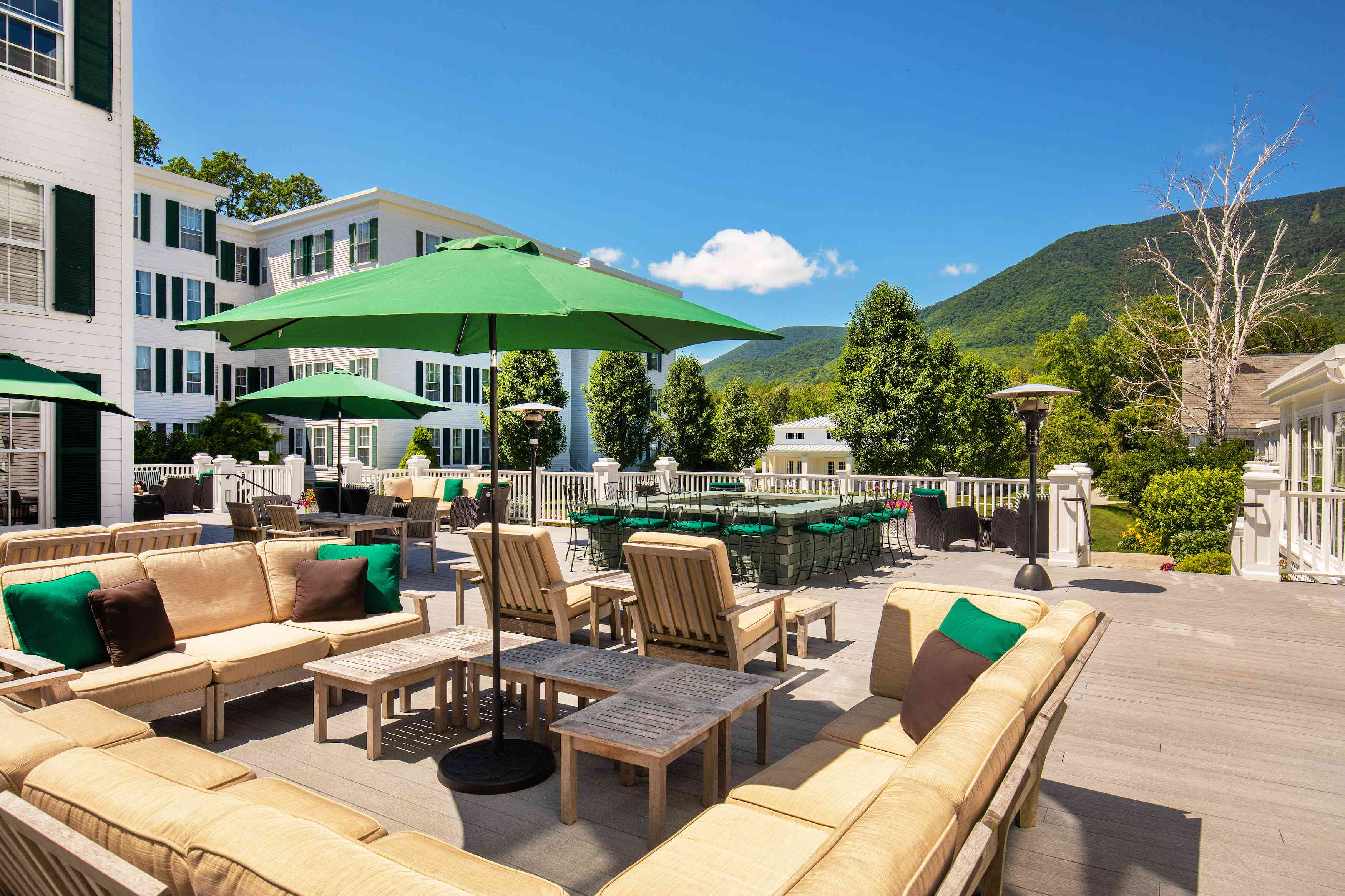 Deck lounge at The Equinox Resort overlooking the mountains in Manchester, Vermont