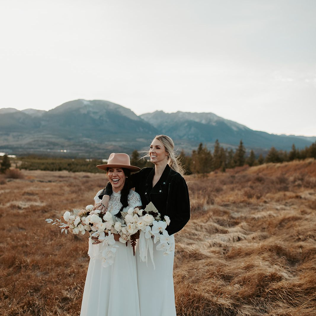 Brides pose with florals in second look