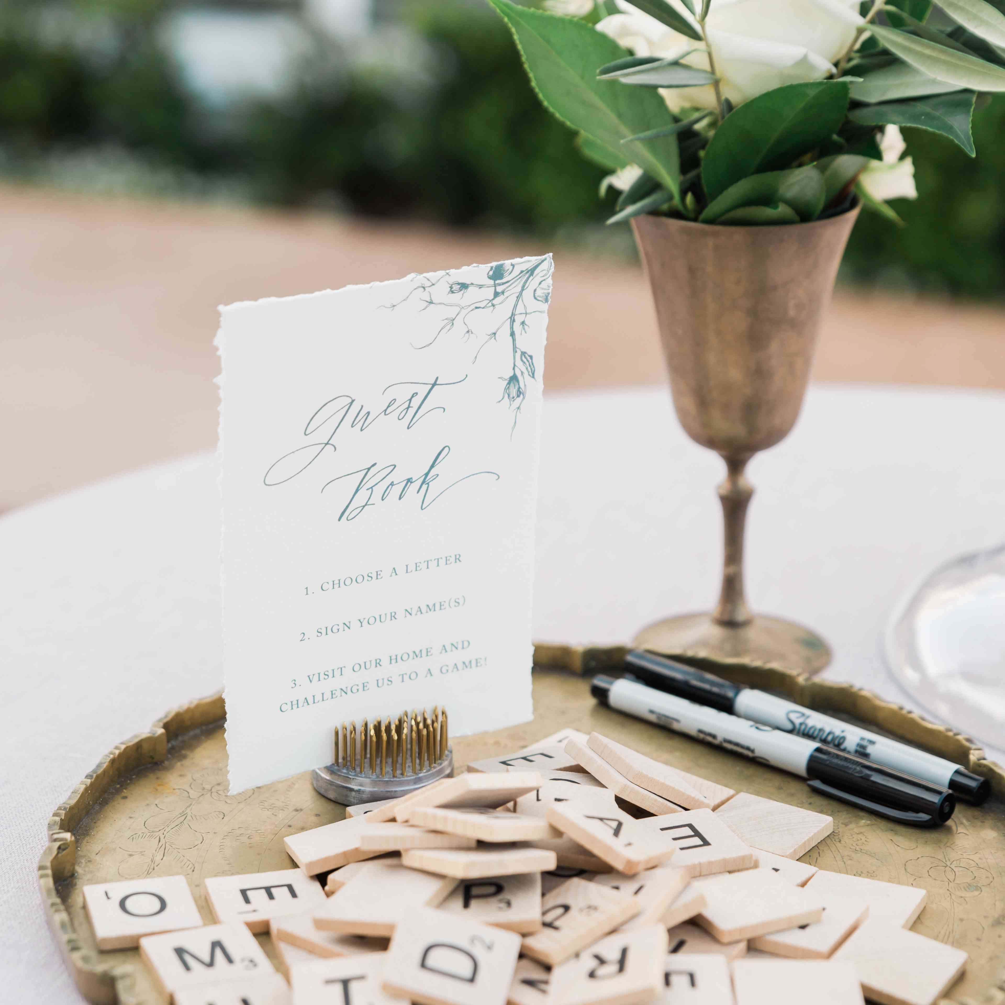 guest book made with scrabble tiles