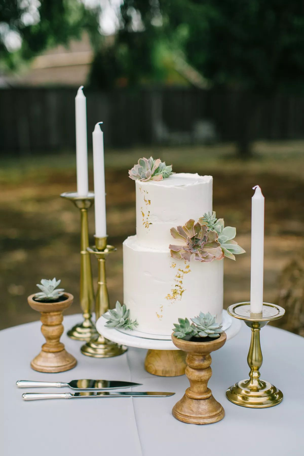 wedding cake table with candles