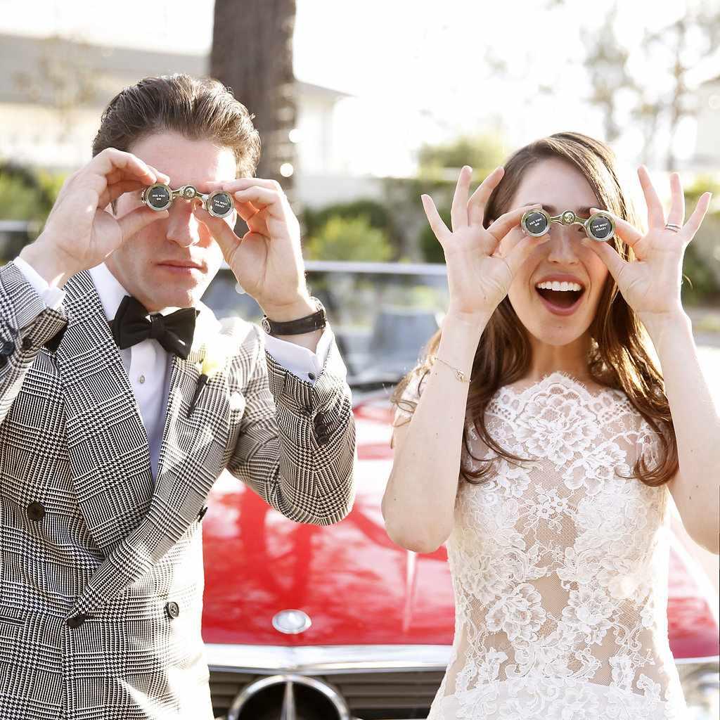 minimalist california wedding, bride and groom with opera glasses