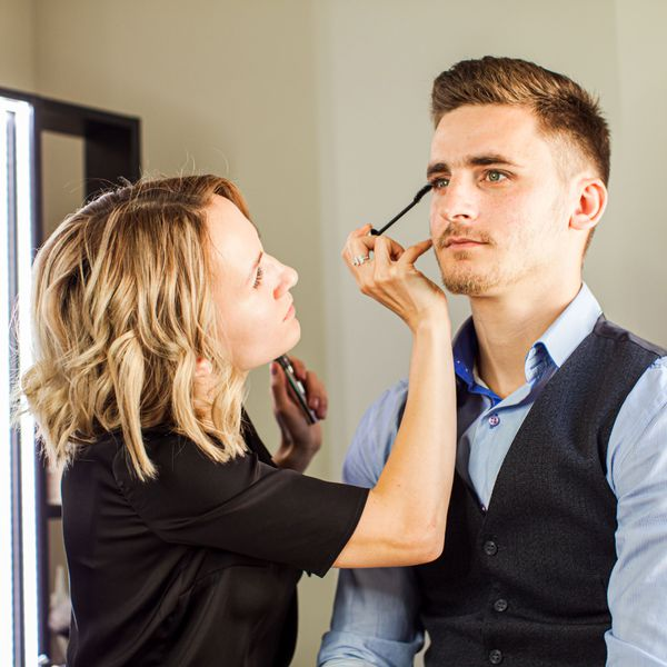 groom with makeup artist