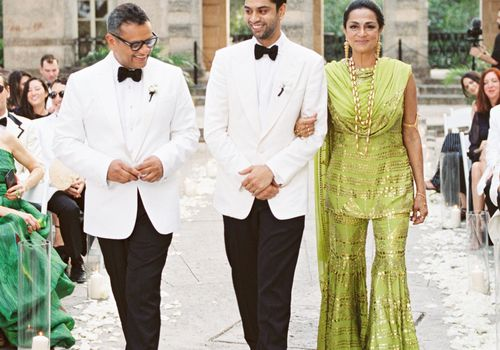 Groom and mother, father, walking him down the aisle