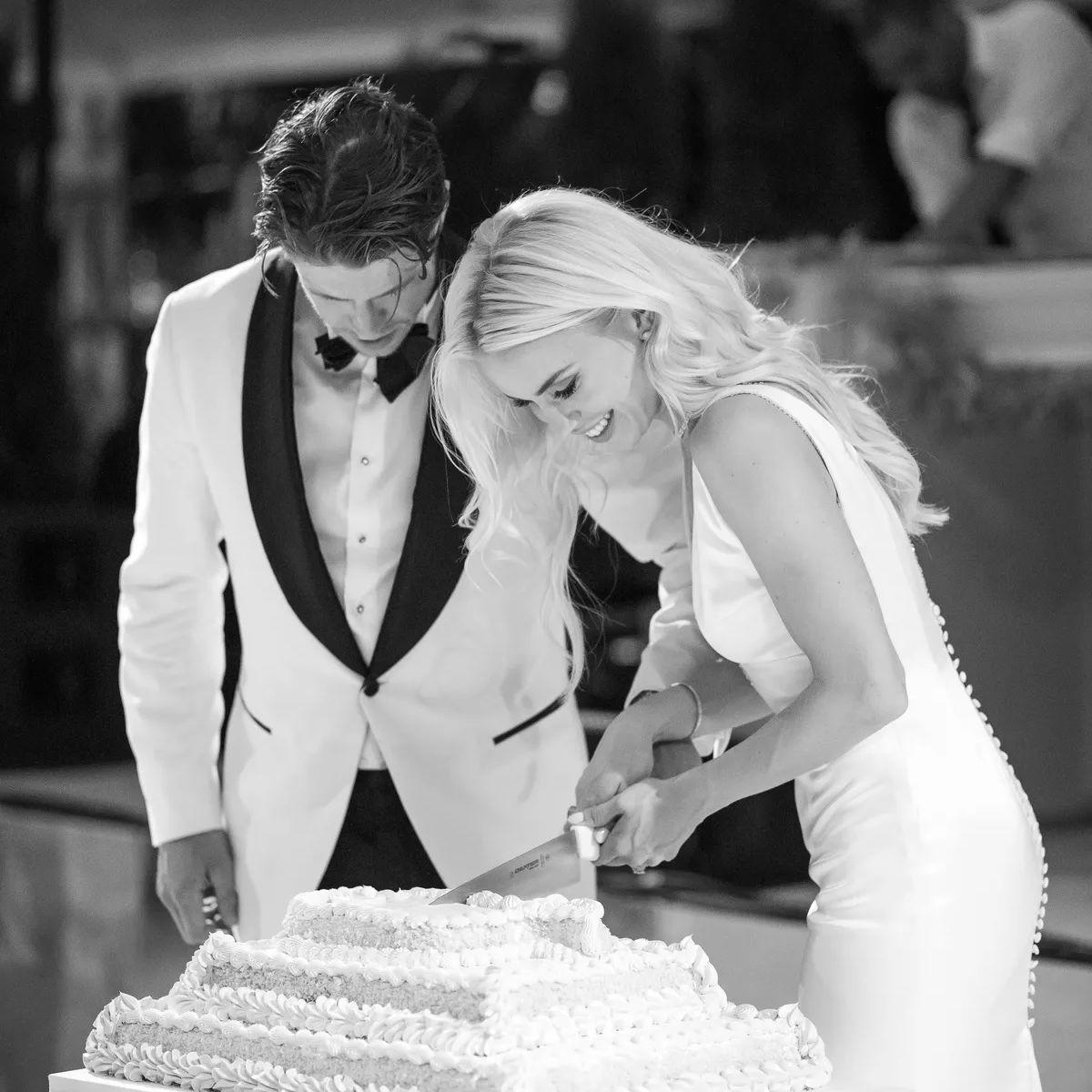 Couple cutting ice cream cake